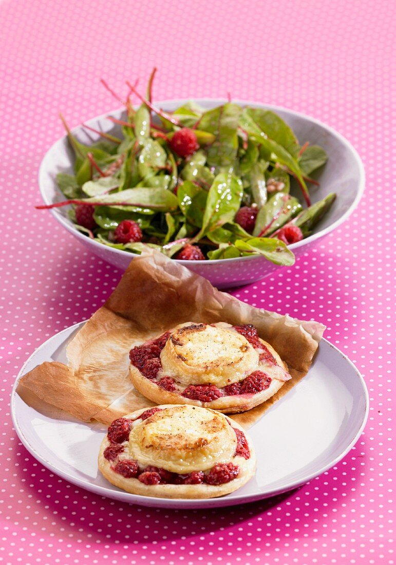 Goat's cheese and raspberry tartlets and a side salad