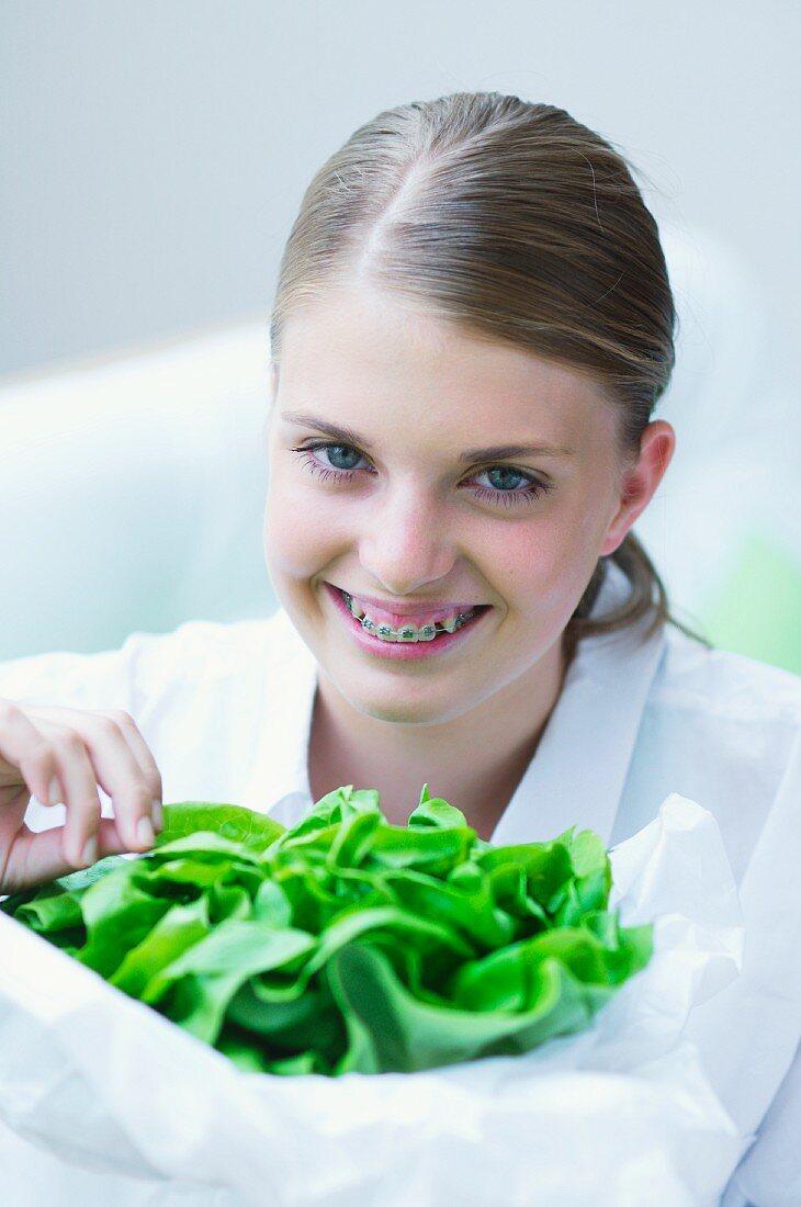 A girl holding lettuce