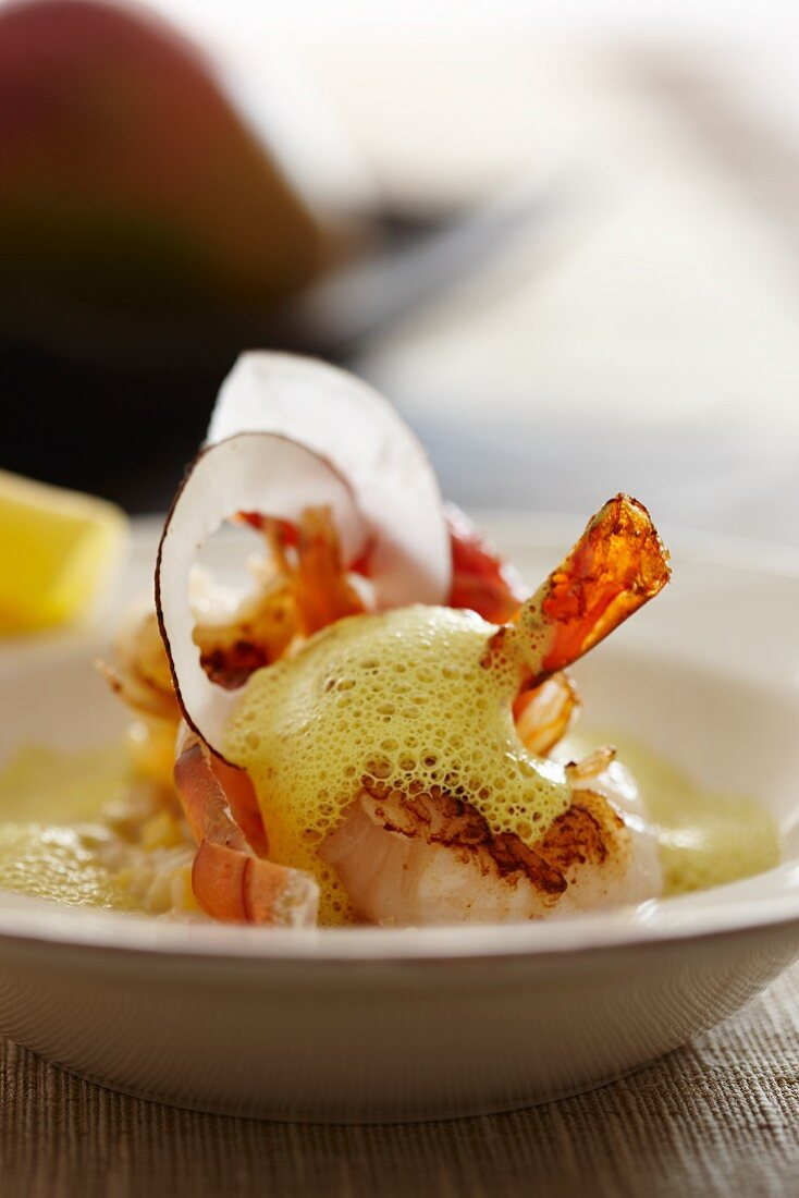 Prawns with mango and coconut risotto and curry sauce
