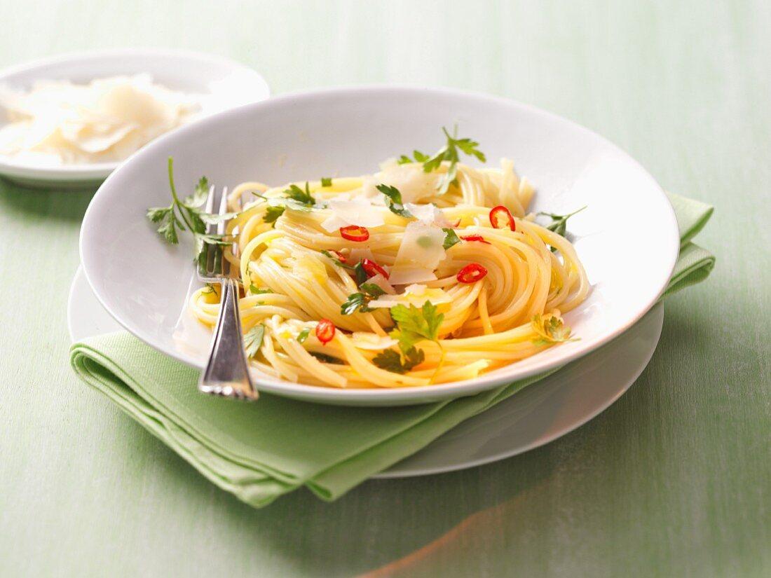 Spaghetti aglio olio with Parmesan and chilli rings