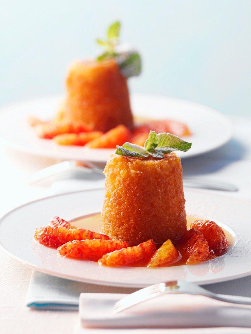 Orange cakes with blood orange fillets