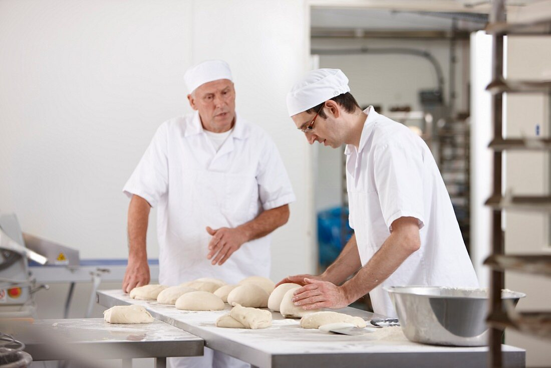 Two bakers at work