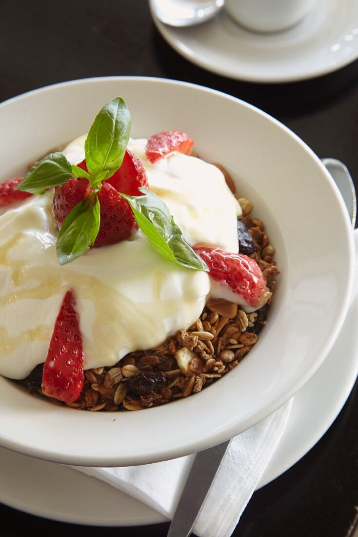 Muesli with yogurt, honey and strawberries