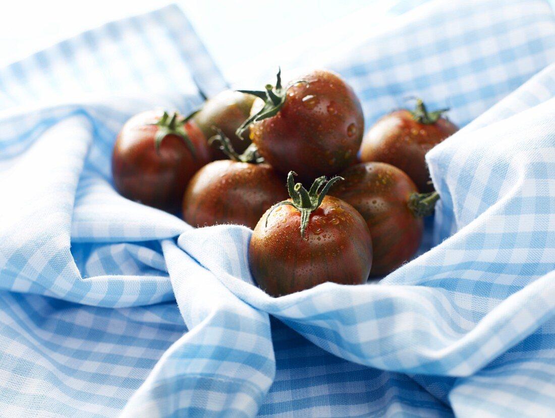 Black Zebra tomatoes on a checked cloth