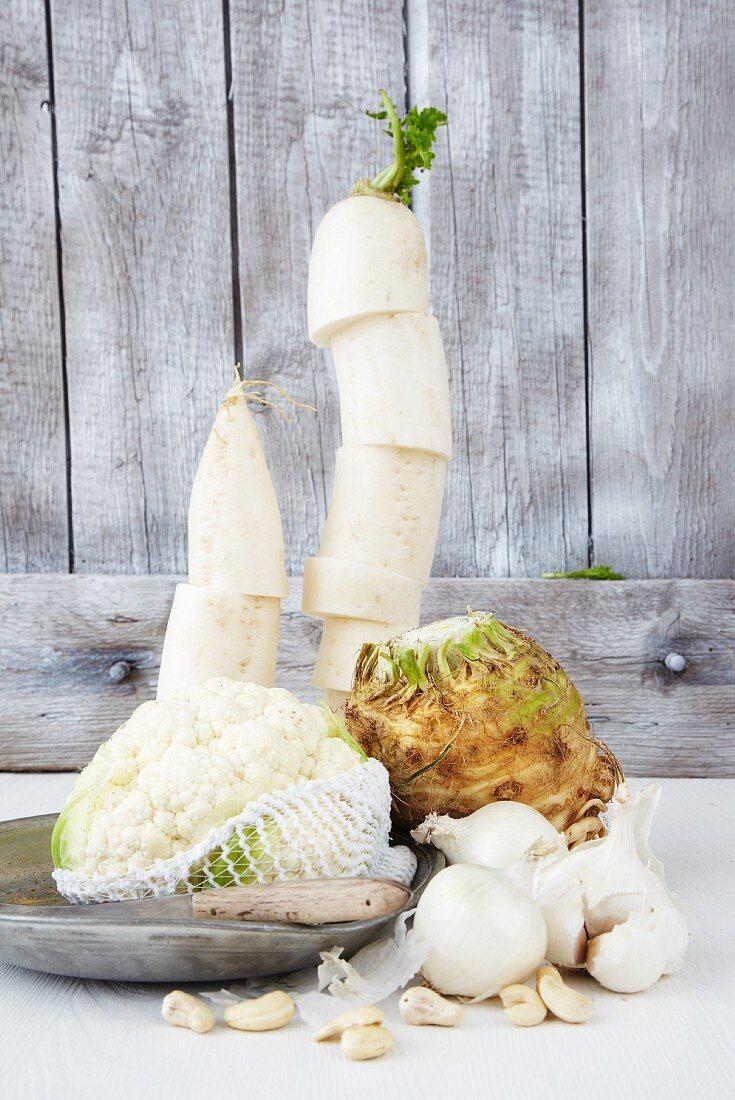 An arrangement of cauliflower, onions, celery and radish