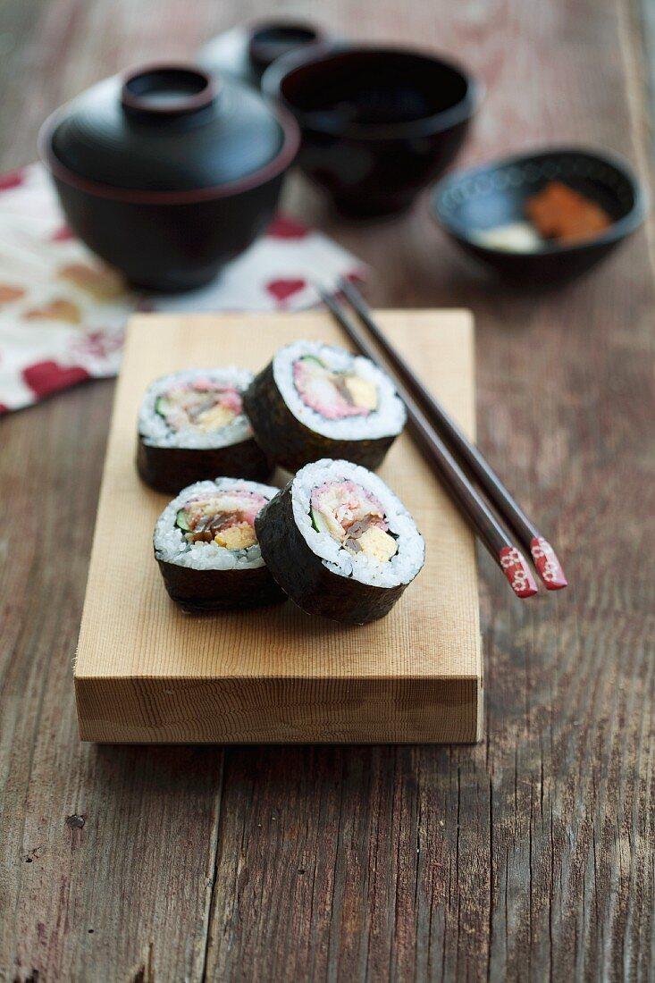 Maki sushi with tuna, egg, cucumber and prawn