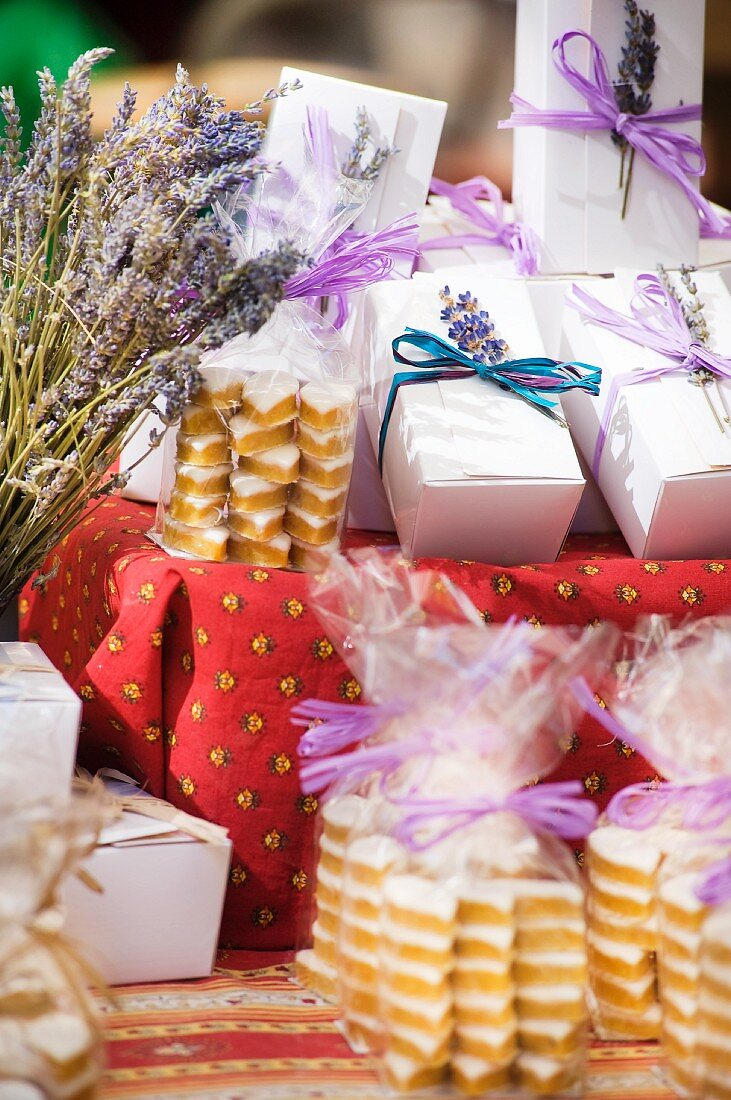 Cakes and pastries in bags and gift boxes on a market stall