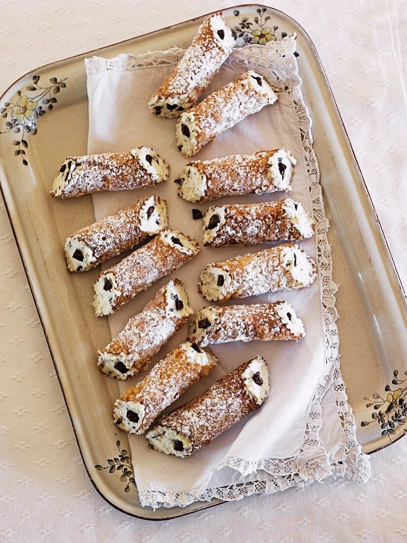 Cannoli (deep-fried pastry tubes filled with ricotta cream)