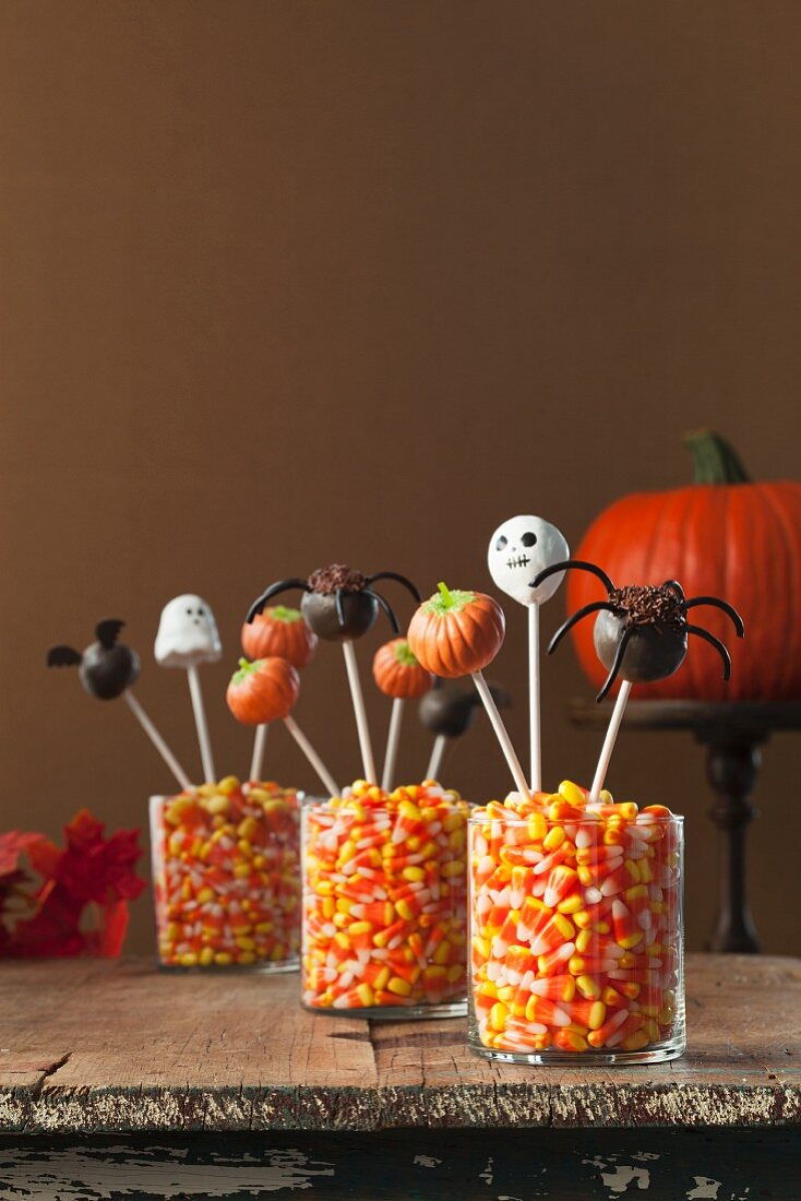 Three Candy Corn Filled Containers with Halloween Cake Pops