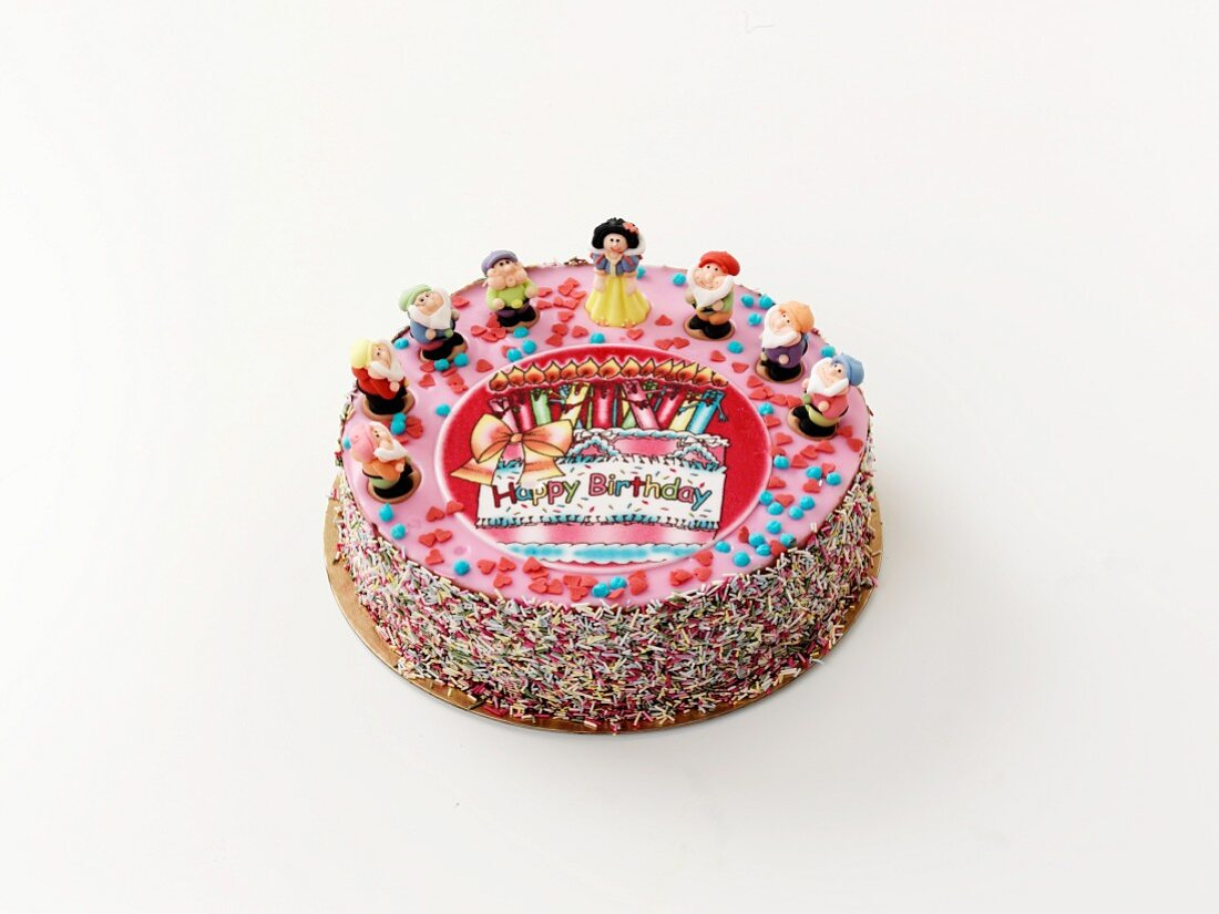 A birthday cake decorated with fairytale figures
