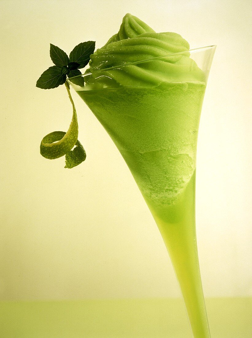 Lime mint sherbet in a champagne flute
