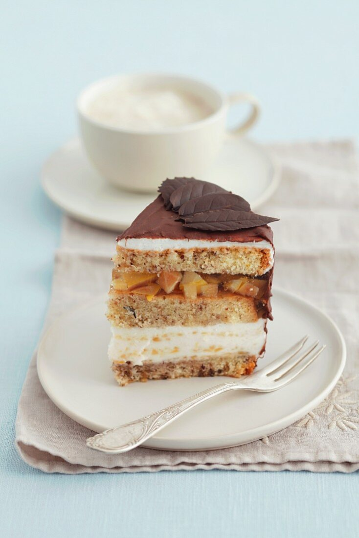 A slice of walnut cake with quince jelly