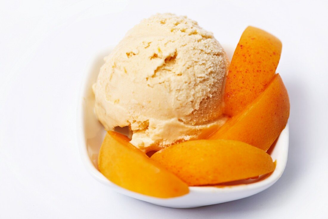 Apricot ice cream garnished with apricot wedges