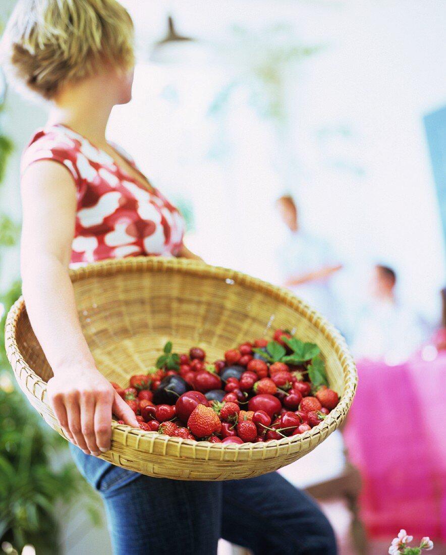 Lady with a large fruit basket