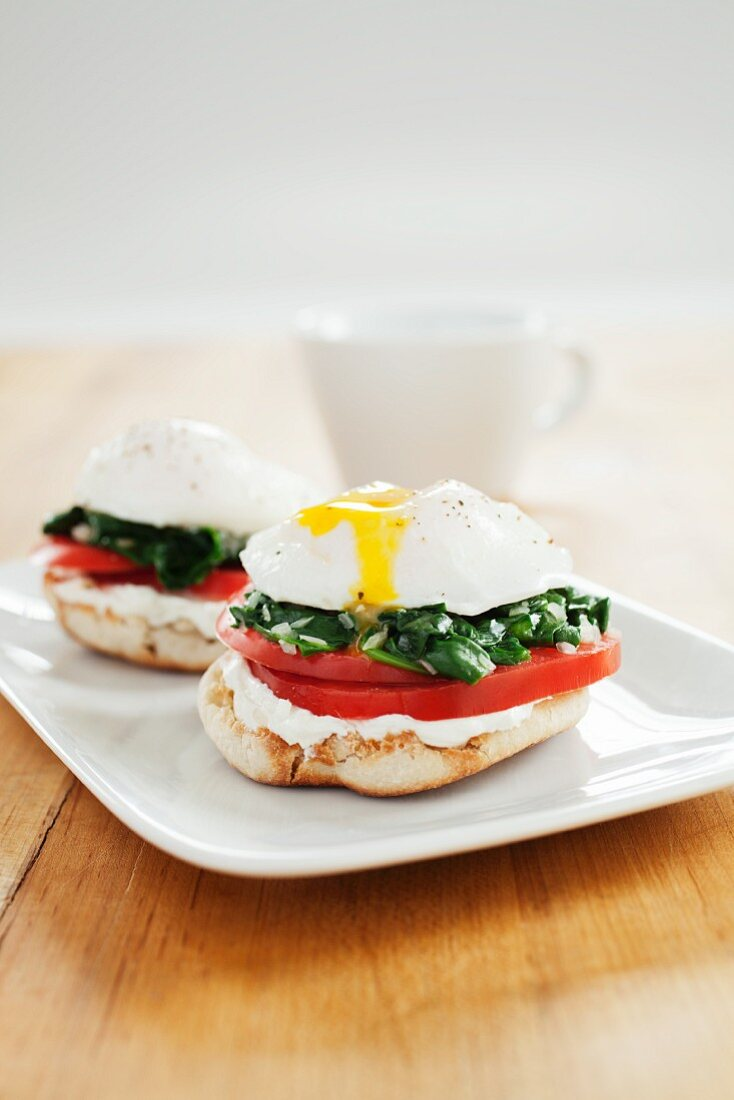 Open Faced Poached Egg Sandwiches on a White Dish