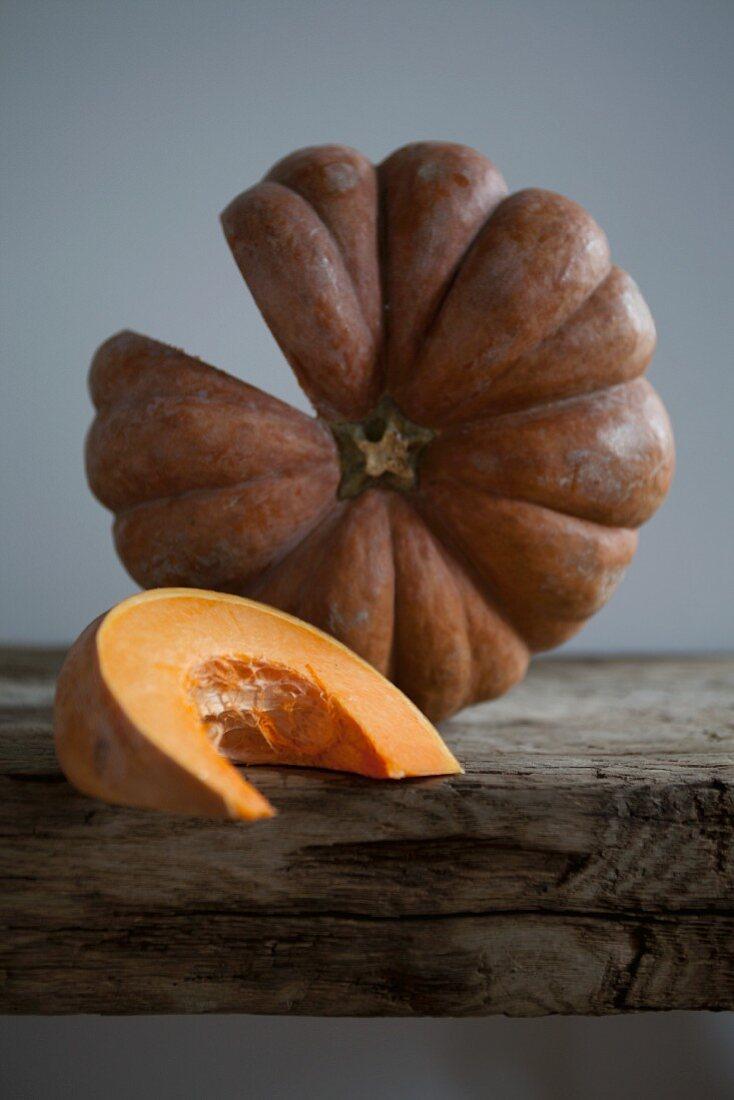 A sliced pumpkin and a pumpkin wedge