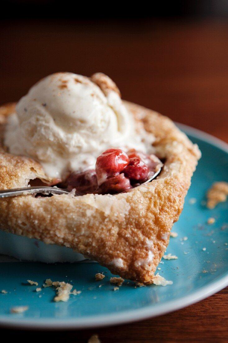 Individual Warm Cherry Pie with a Scoop of Vanilla Ice Cream