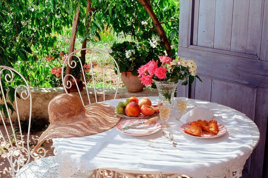 Garden table under a peach tree