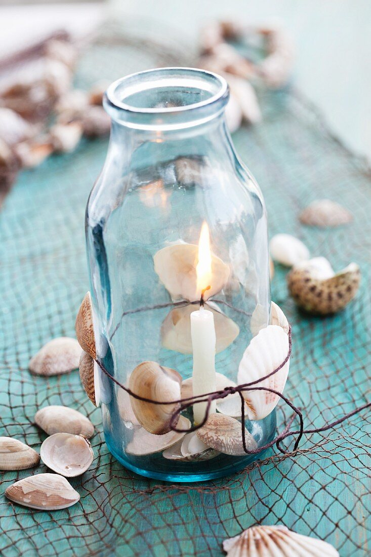 Jar with cord, shells and candle