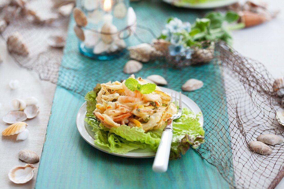Fried seafood on lettuce leaves
