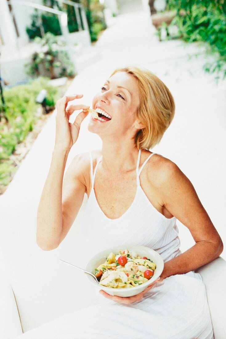 Woman eating outdoors