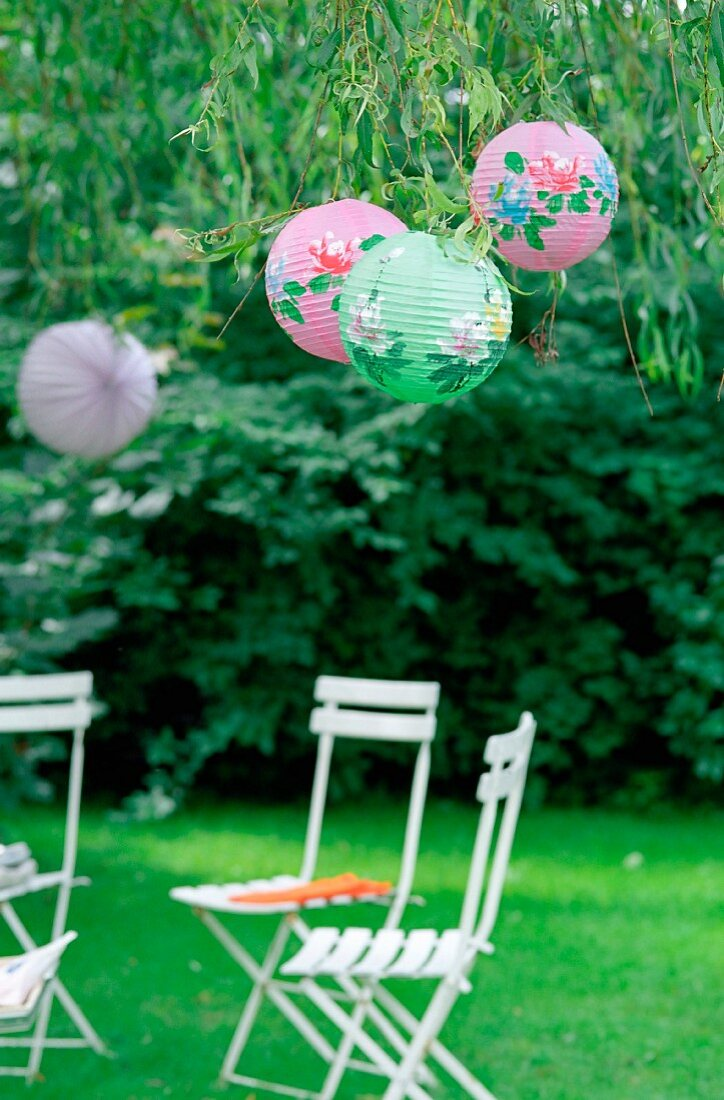 Garden chairs under lampshades