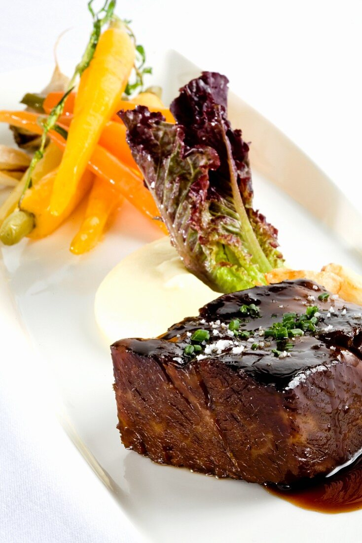 Slow Roasted Short Rib with a Dark Glaze, Roasted Baby Carrots and Mashed Potatoes