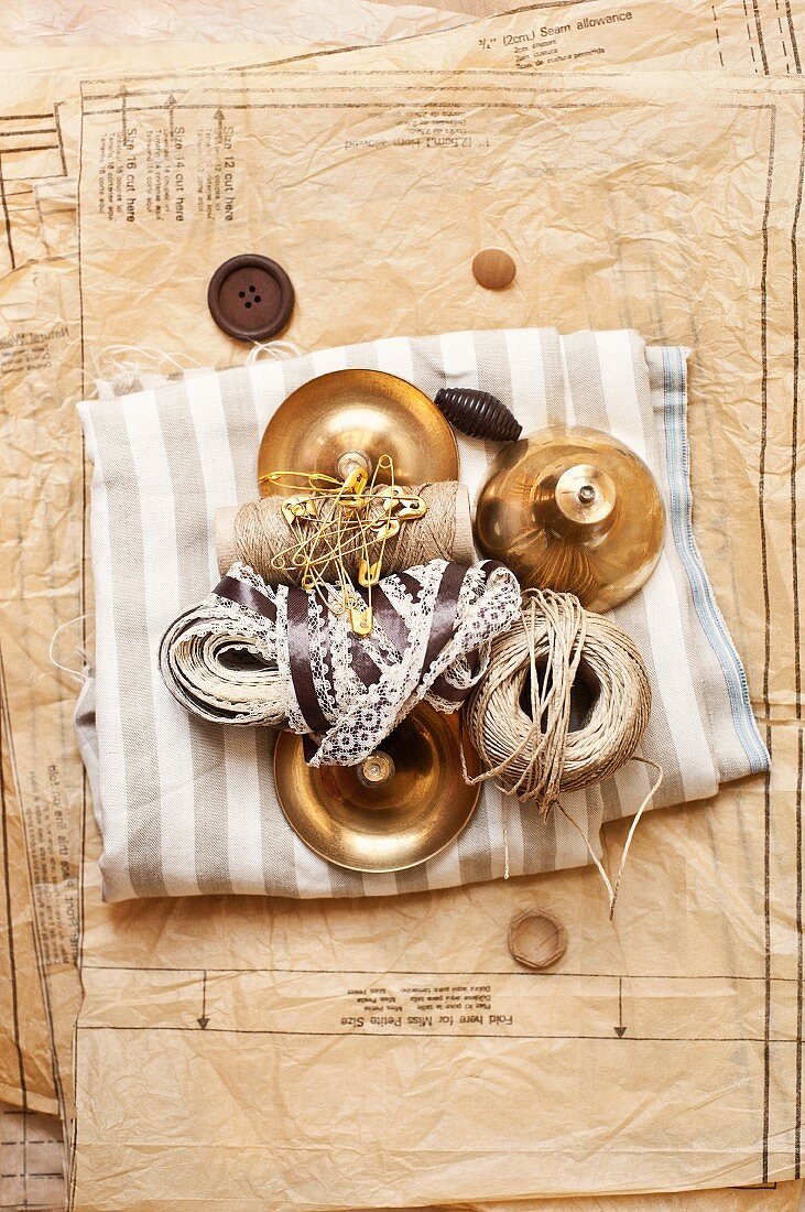 Sewing equipment: paper pattern, fabric, buttons & ribbons