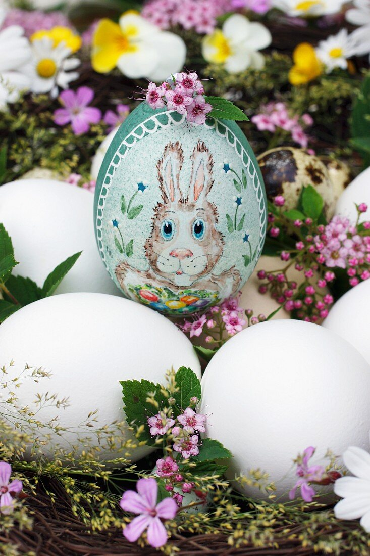 A handmade Easter egg with a bunny motif