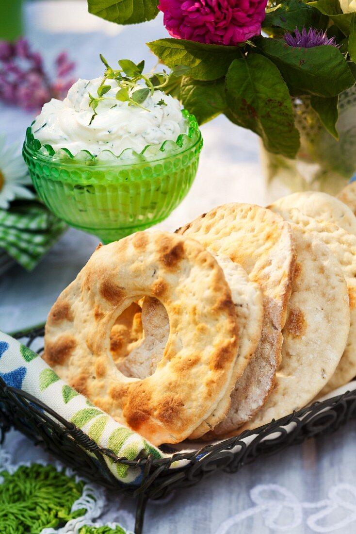 Round crisp breads with herb cream