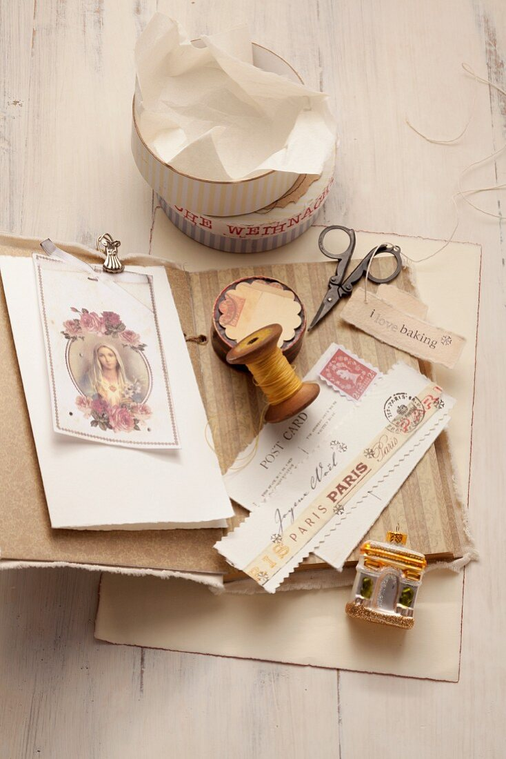 Postcards, stamps, twine and an empty biscuit tin