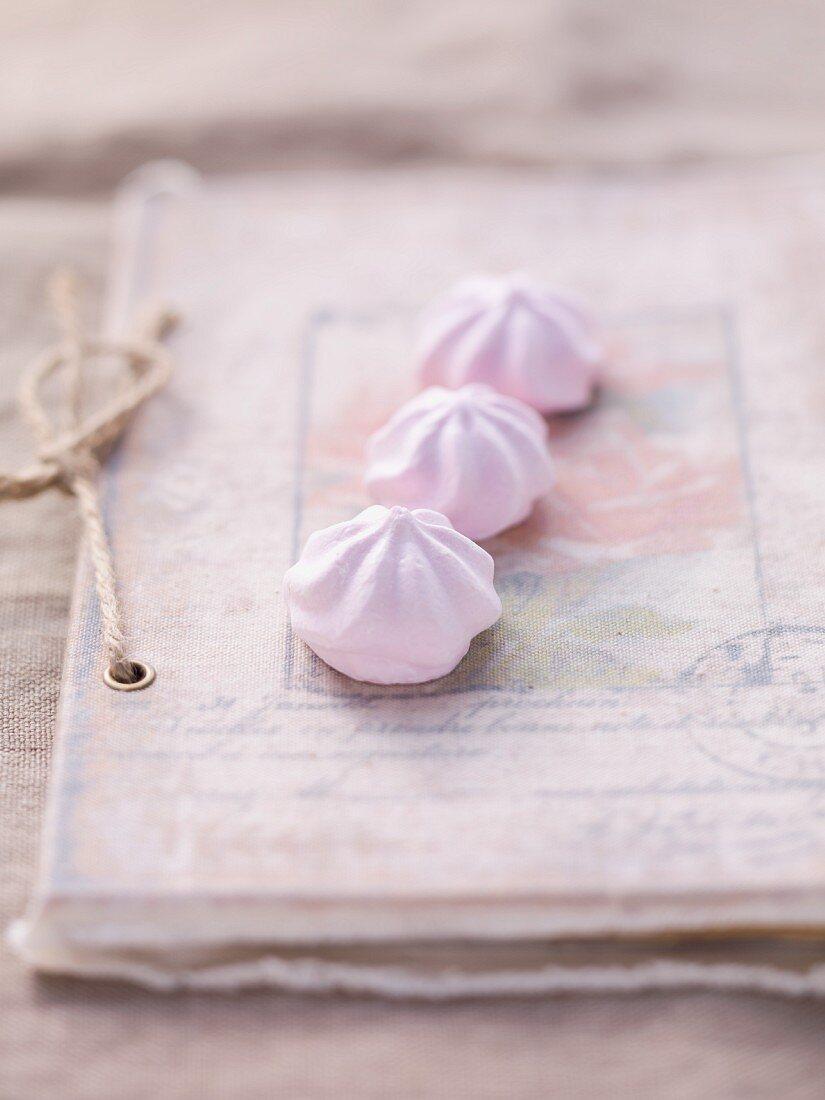 Three meringues on a vintage book