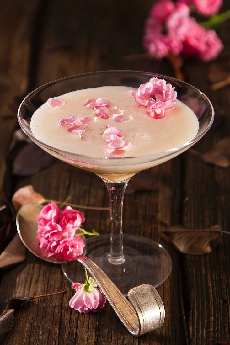 Wine soup made with white wine, egg yolks and cream with rose petals