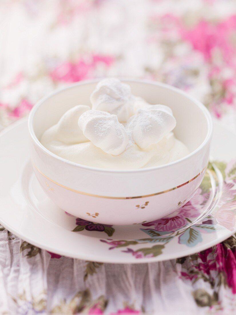 Quark cream with meringues in a bowl