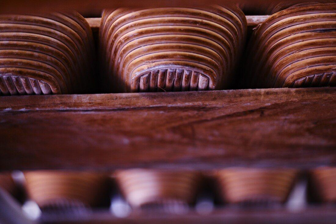 Bread baskets on a wooden shelf