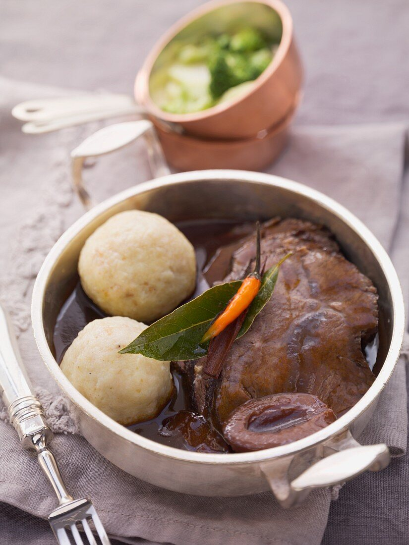 Beef pot roast with dumplings and sour damsons