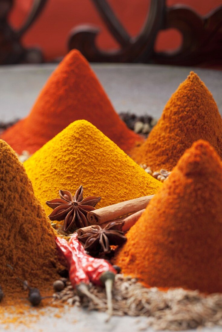An arrangement of piles of spices