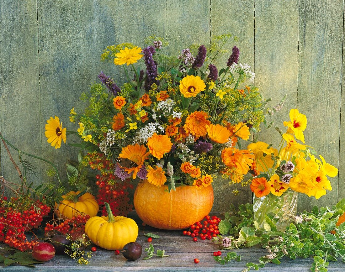 A bunch of herbs featuring marigolds, anise hyssop, Chinese chives, nasturtiums, mint, fennel, rowan berries and a pumpkin