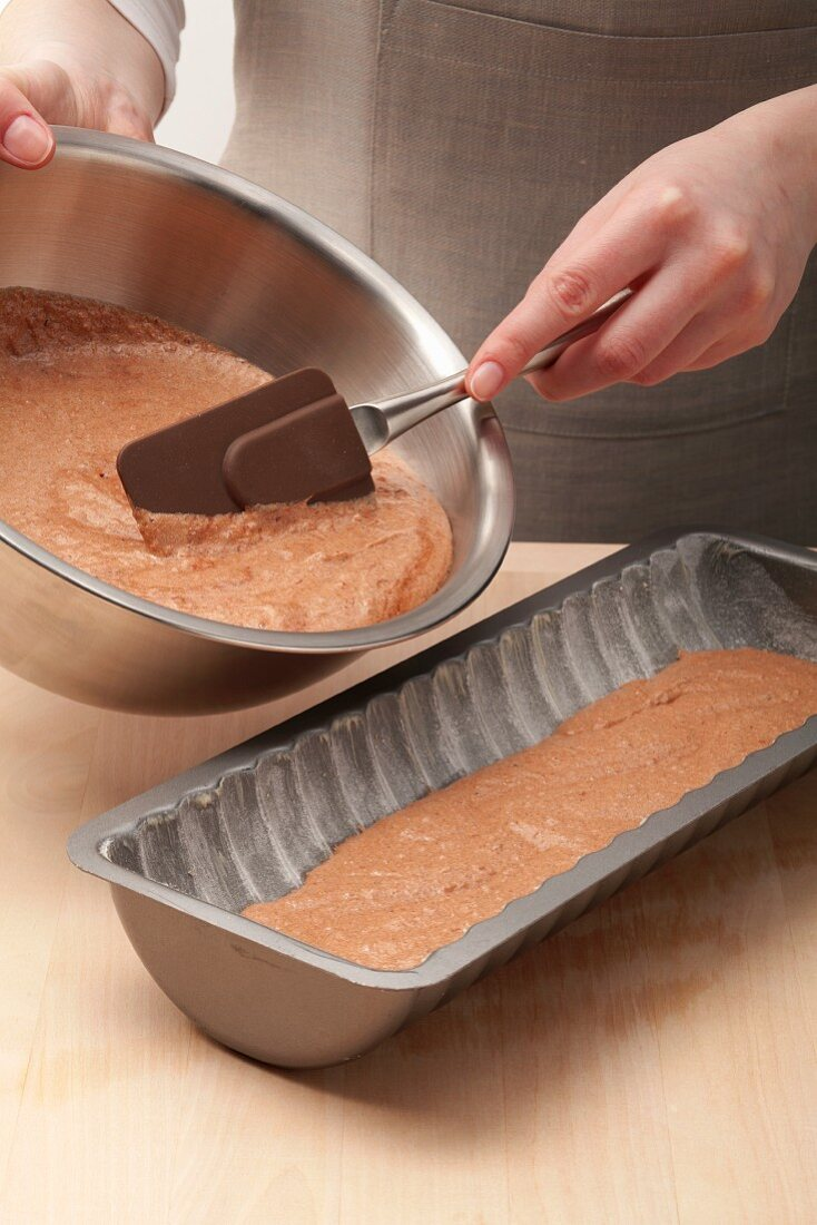 Cake batter being poured into the Rehrücken mould