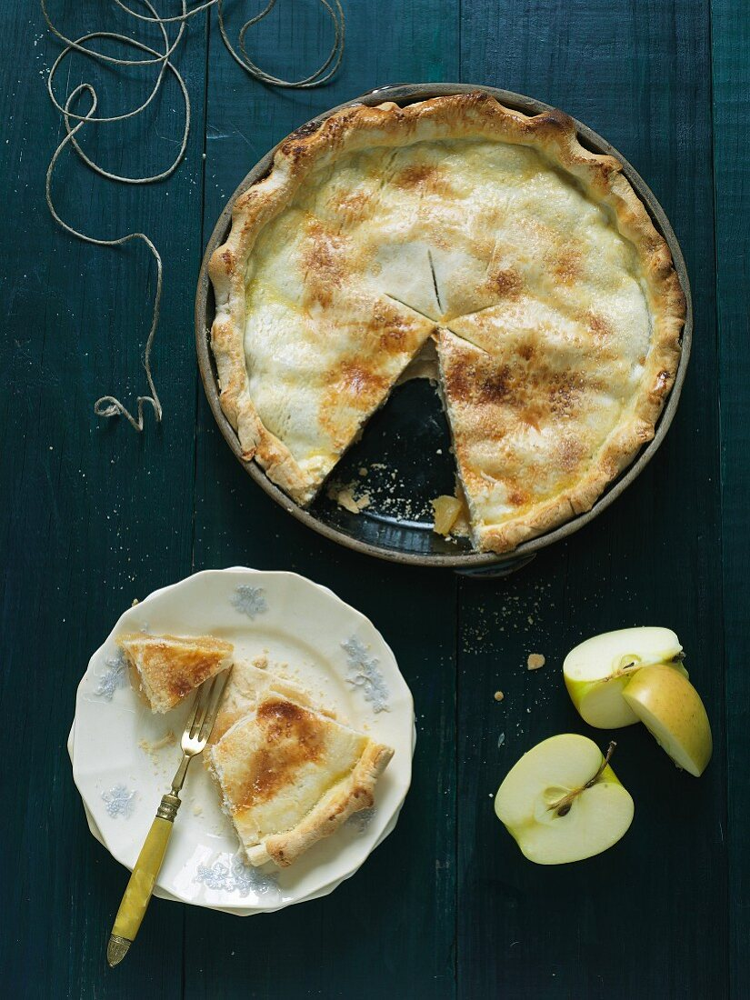 Apple Pie with a Sliced Removed and on a Plate; From Above