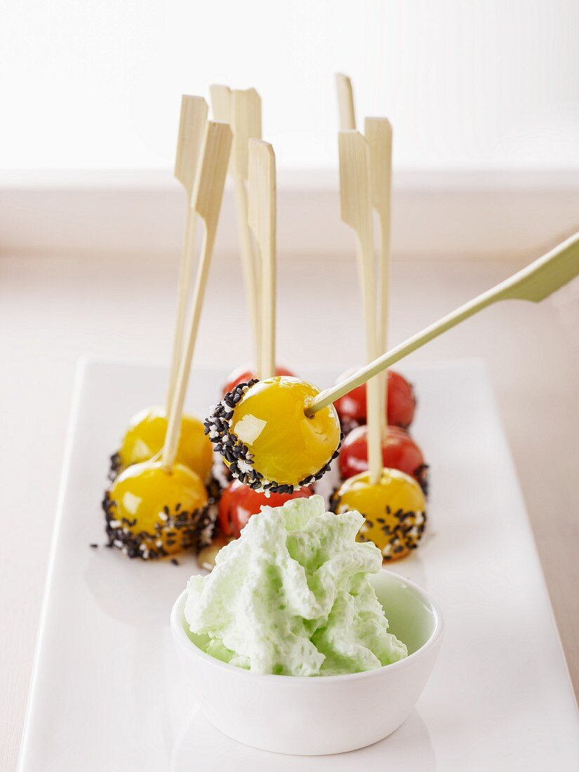 Cherry tomato skewers with sesame seeds and a wasabi dip