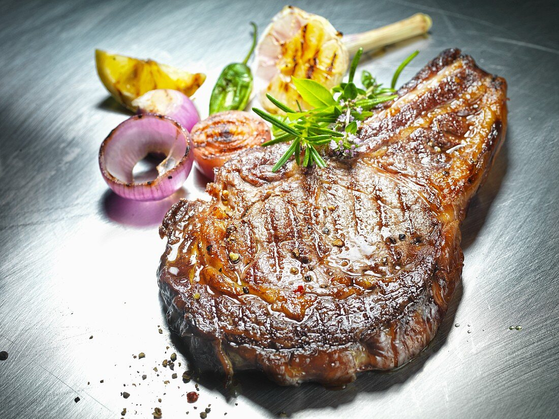 Grilled beef steak with garlic and onions