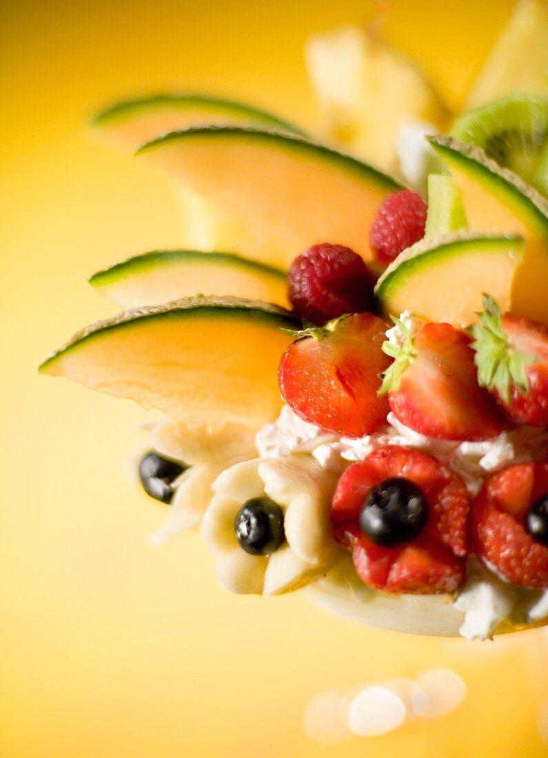 A fruit sundae with mixed fruit ice cream and fresh fruit