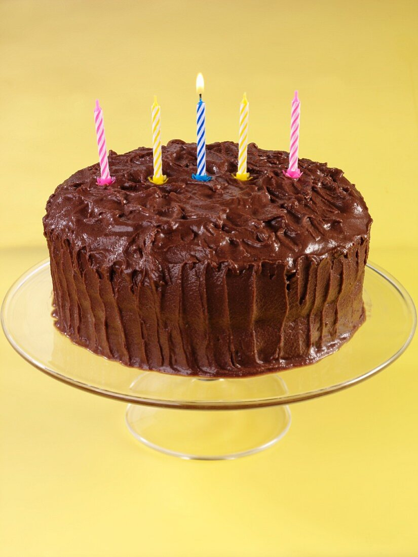 Devil's food cake (chocolate layer cake, USA) with birthday candles