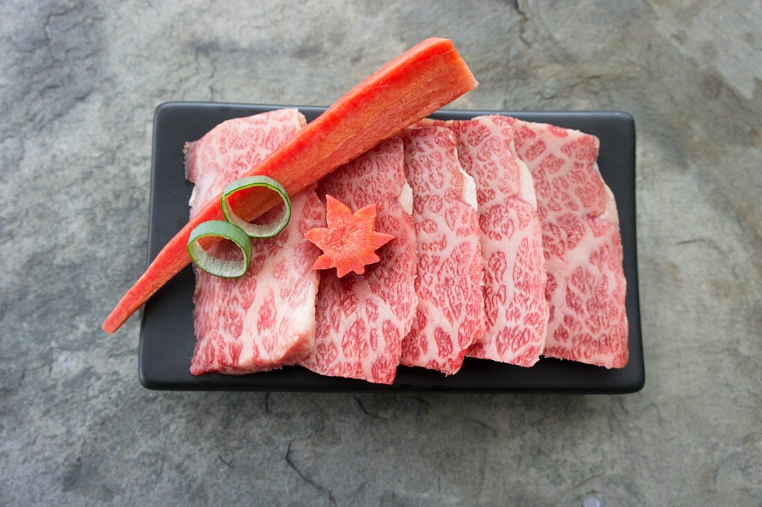 Thinly sliced raw Wagyu beef for teppanyaki