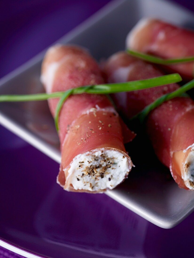 Rolled Parma ham with ricotta and thyme filling