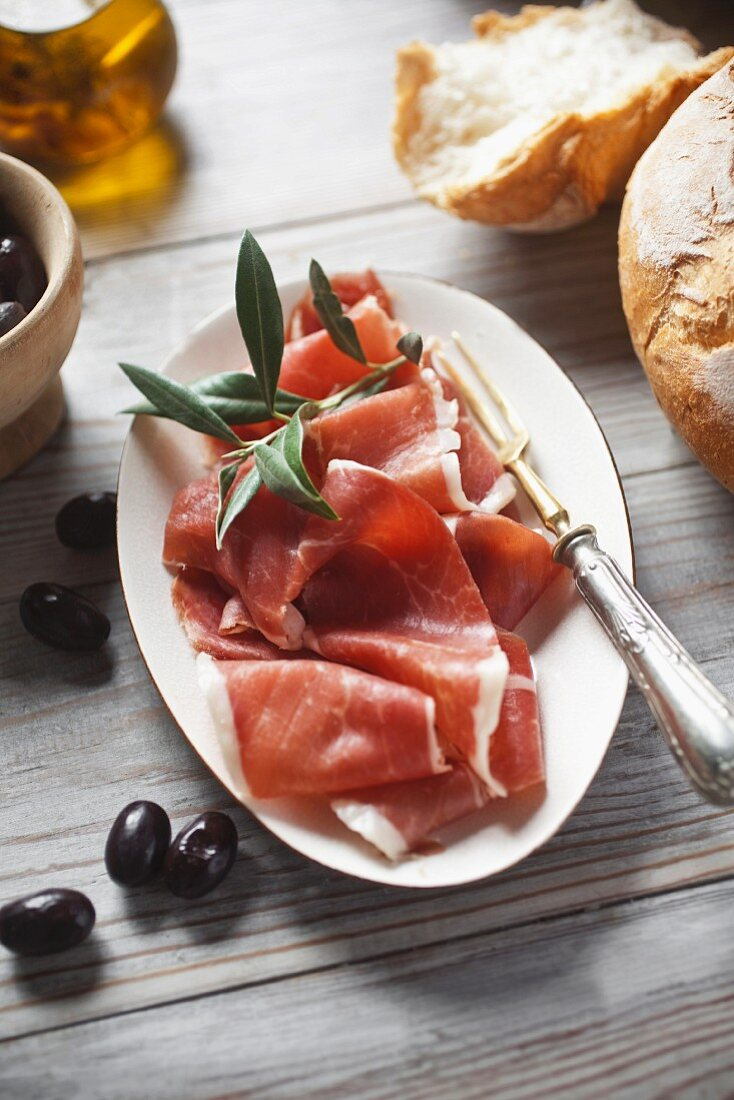 Serrano ham with bread and olives