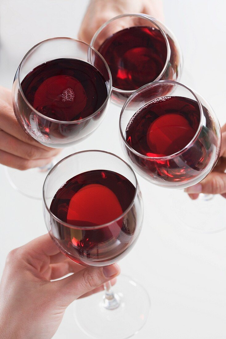 Closeup of hands toasting with wine