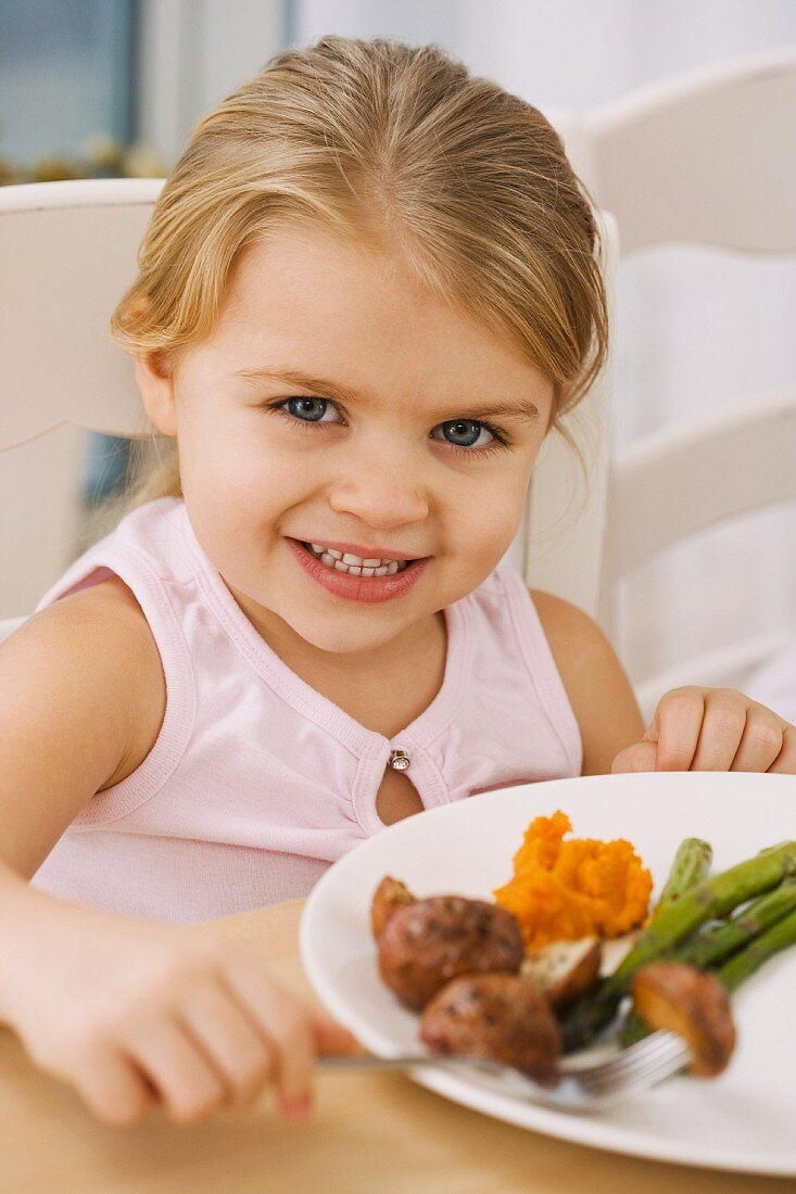 Portrait of girl at dinner table