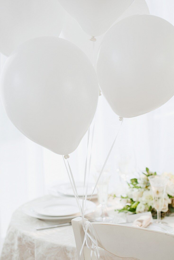 Wedding table set in white with white balloons